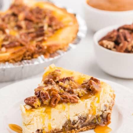 A slice of caramel pecan cheesecake