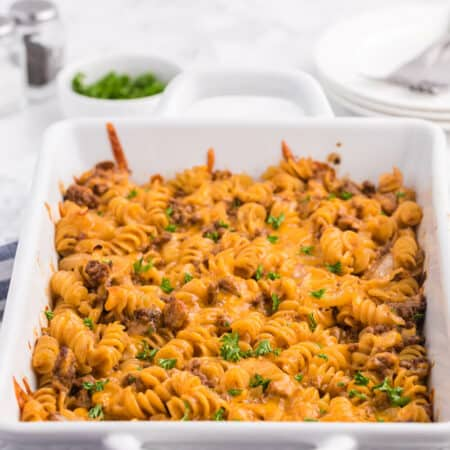 Cheesy BBQ Beef Casserole - Ground beef, cheese and tangy BBQ sauce create a quick, easy and cost-effective family meal that everyone is sure to enjoy. This dish is a great make-ahead meal, and makes a great lunch the next day!