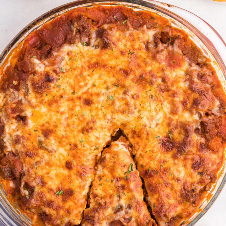 Spaghetti Pie - Lasagna + spaghetti = a big family hit! Using simple pantry ingredients, along with ground beef, and chili powder, this is a delicious crowd-pleasing meal.