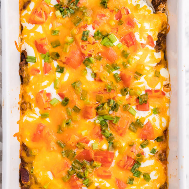 Taco Casserole - A fun twist on Taco Tuesday! This easy casserole has all the ingredients we love about tacos, baked together in one convenient baking dish - quick to make and quick to clean up!