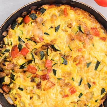Caramelized Onion, Red Pepper & Zucchini Frittata - Loaded with red pepper and zucchini, this veggie-packed dish is healthy and filling - and low carb too!