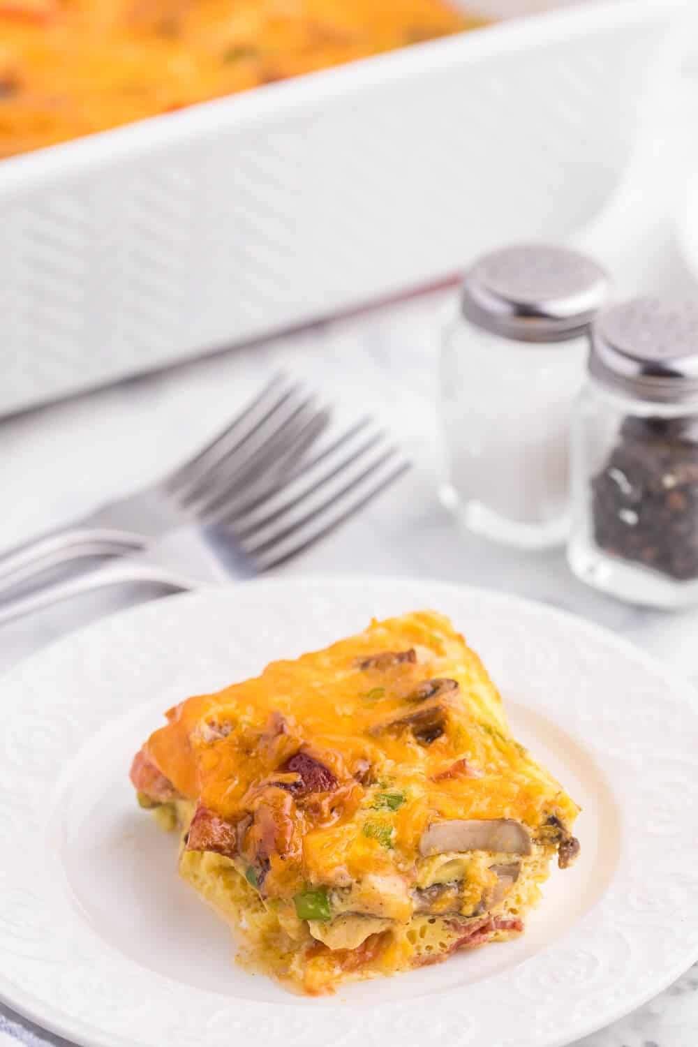 Crustless Bacon and Cheese Quiche - Rich, creamy eggs with bacon and cheese are a fantastic, lower carb option for brunch or dinner. Served with fruit or mixed greens, this is delicious and satisfying, no matter what time of day you make it!