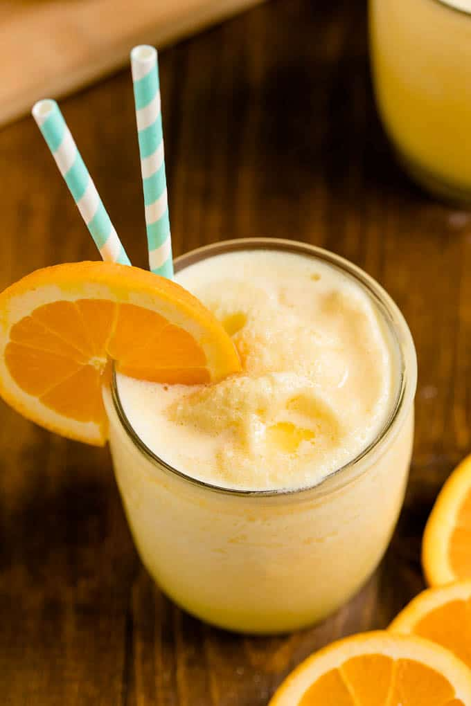 Orange Julius Copycat Recipe - The classic orange and vanilla flavour of this sweet and creamy drink is refreshing and satisfying, and much less expensive than a trip to the mall!