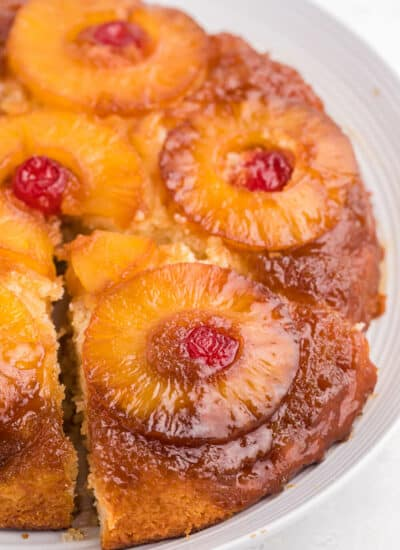 Pineapple upside down cake with a slice out of it