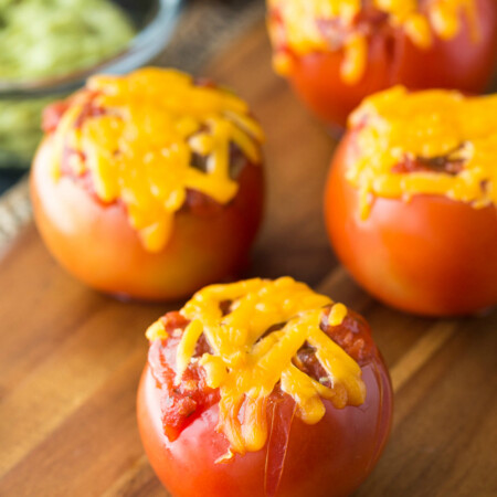 Guacamole Tomato Boats - Stuffed tomatoes with a Mexican flair! Serve them at a party or for a healthy snack.