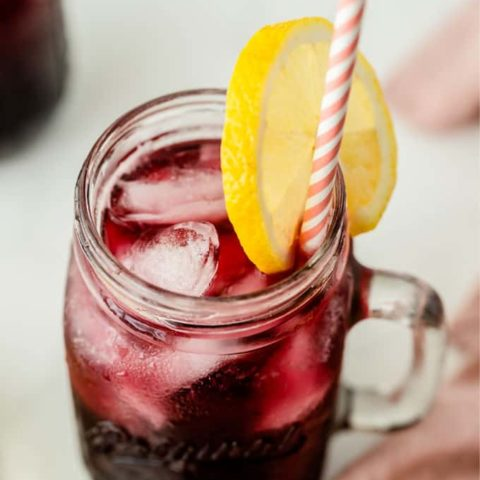 Sparkling Grape Lemonade - With bubbly lemon lime soda, frozen grape punch and lemonade, this drink is so easy to make when entertaining, or when you want to treat the kids to a special summery drink.