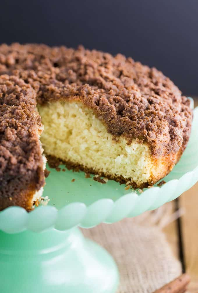 Streusel Coffee Cake - Another classic cake - for good reason! The crumbly cinnamon topping and the moist cake are the perfect pairing with a hot cup of coffee! This is a great make-ahead cake to have in the freezer for unexpected guests.