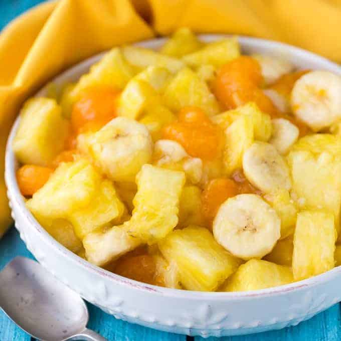 Sunshine Salad - The brightest fruit salad filled with pineapple, bananas and mandarin oranges! This low-calorie option is perfect for summer with only 4 ingredients.