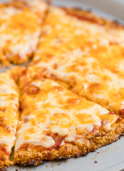 Cauliflower Pizza Crust - Perfect for keto and low-carb diets! This crispy crust is made from veggies and cheese and topped with your favorite pizza toppings.