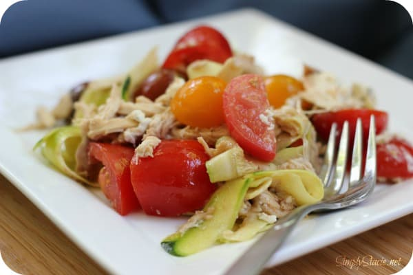 """Creamy Zucchini """"Pasta"""" with Tomato - Ditch the carbs with this keto-friendly recipe! These zoodles are fresh and light with tomatoes, shredded chicken, goat cheese, and balsamic vinegar. Perfect for cookouts."""