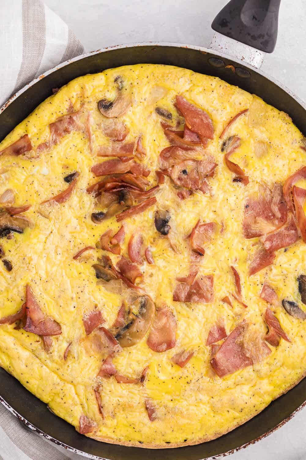 Turkey Bacon Frittata - Cut a few calories on this amazing brunch dish! Swap the pork for turkey in this delicious egg dish that's perfect for breakfast or dinner.