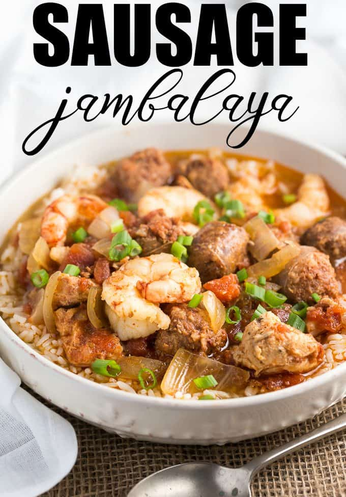 Get the flavors of New Orleans in this Sausage Jambalaya recipe! Chicken, shrimp and sausage come together in this slow cooker three meat jambalaya that is bursting with Cajun flavor.