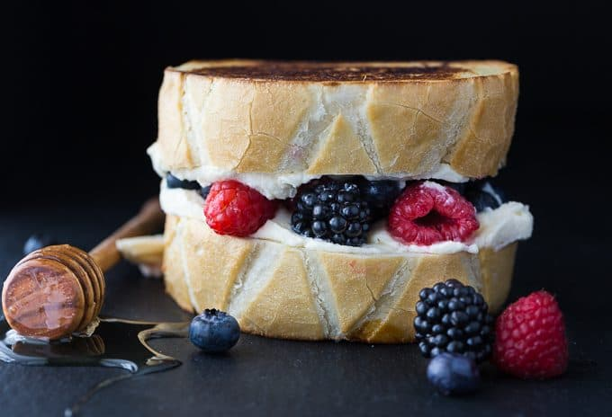Dessert Grilled Cheese Sandwiches - Not your typical grilled cheese sandwich! It's filled with creamy mascarpone cheese, fresh sweet berries and a drizzle of honey.