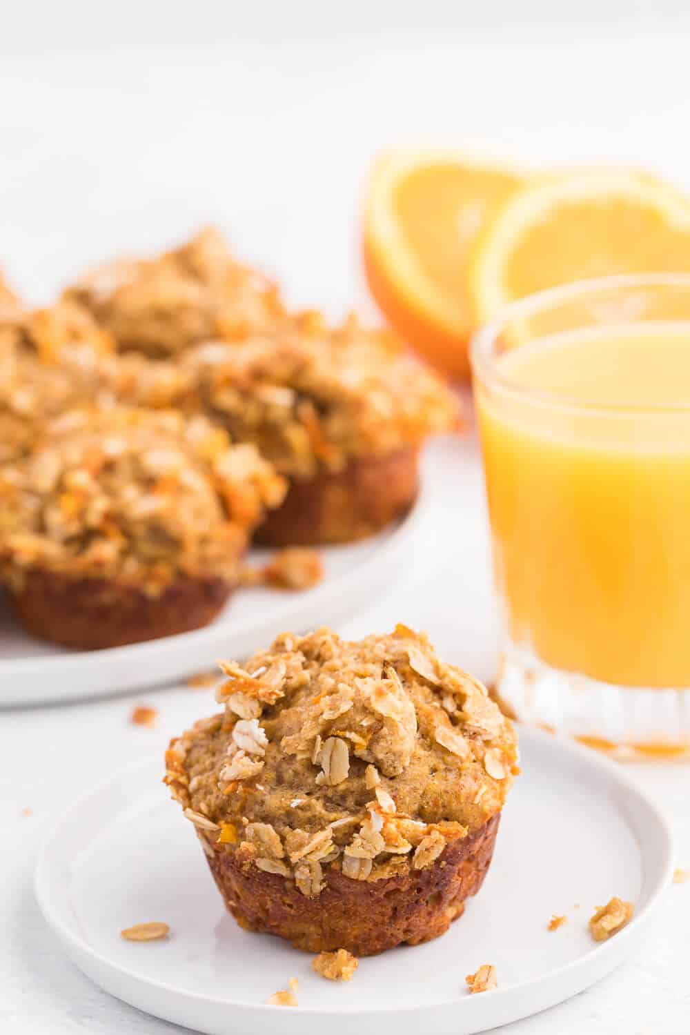 Double Orange Muffins - Packed full of goodness with carrots, orange juice, oat bran, flax seed, Greek yogurt and more. Make the night before to save time in the morning. Healthy and delicious!