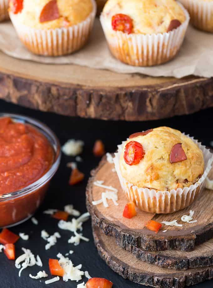 Pizza Muffins - This kid friendly snack tastes and smells like pizza, but in a muffin form. Add in your fave toppings to change it up!