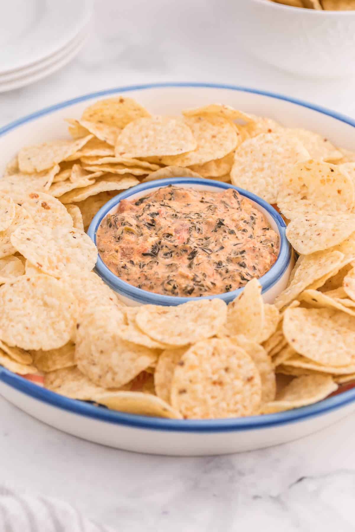 Tex-Mex Spinach Dip - Add a new kick to your classic spinach dip recipe! This appetizer is super creamy with just 5 ingredients. Just dump, heat, and serve.
