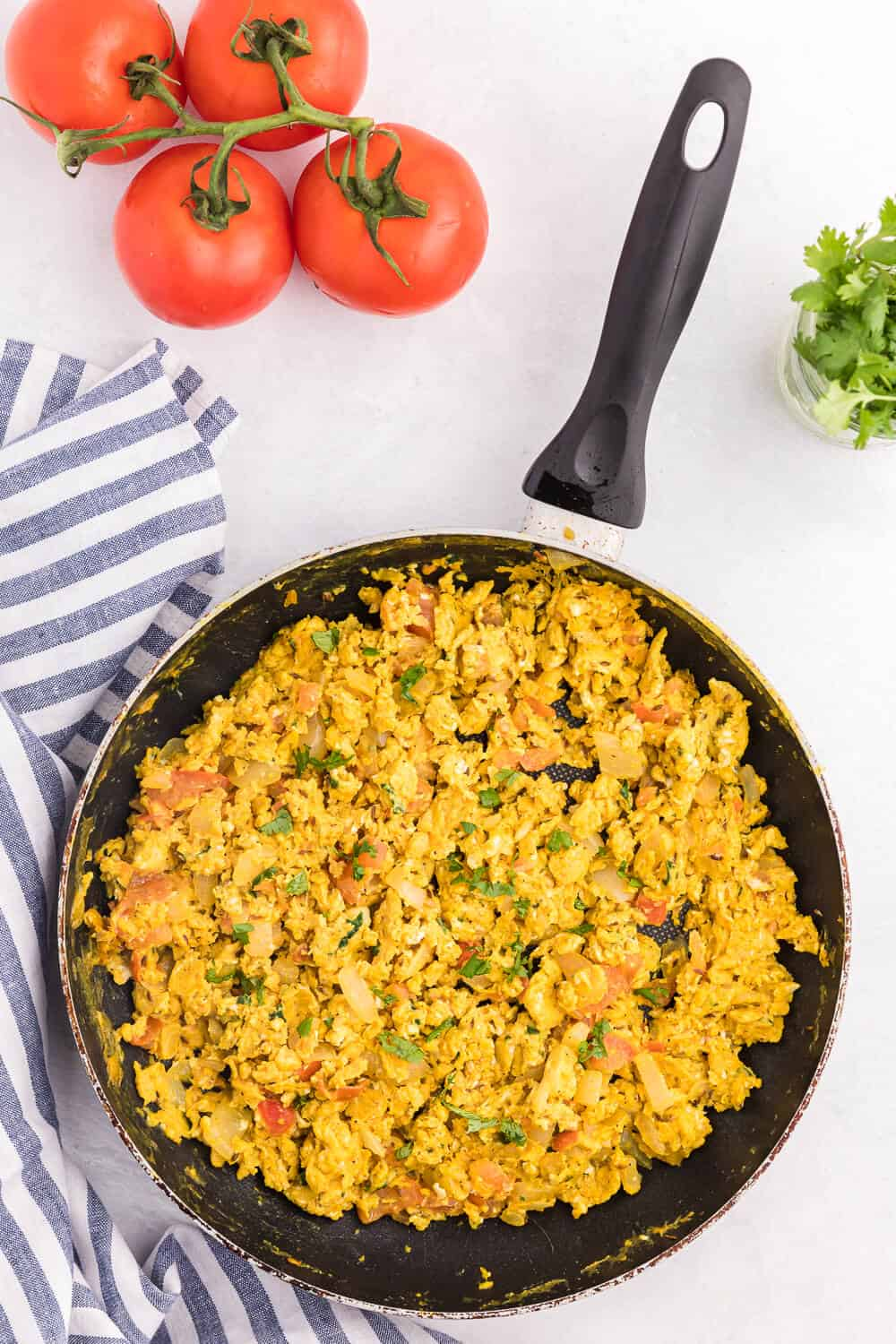 Indian Scrambled Eggs - Bring Indian seasonings to the breakfast table! This quick morning staple is packed with cumin, onion, green chiles, tomatoes, turmeric, and cilantro.