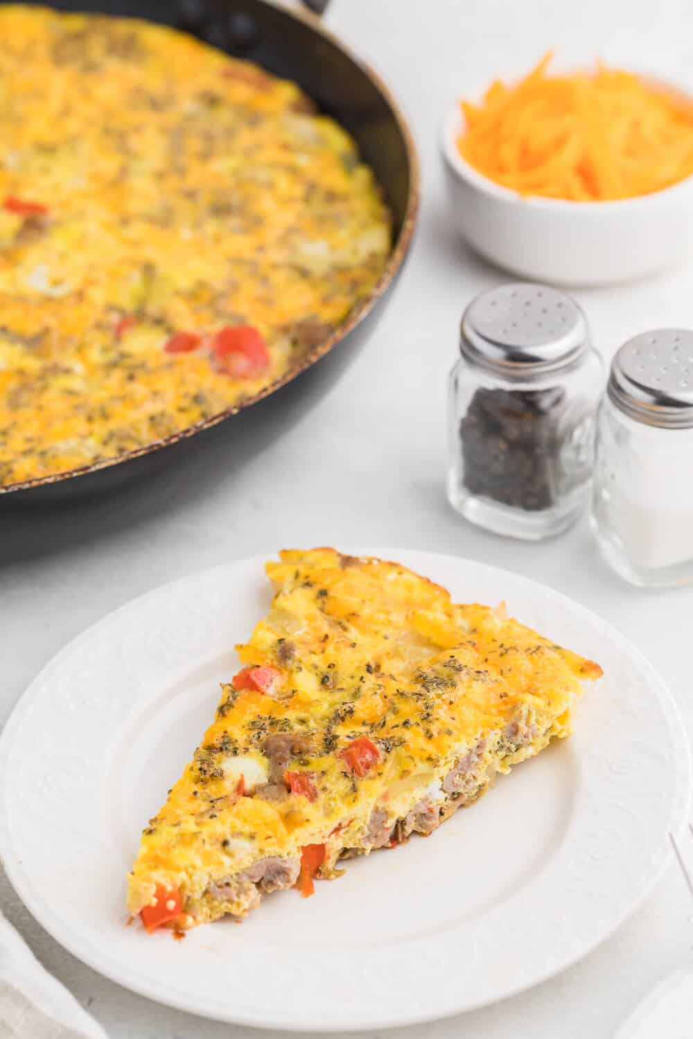 Sausage & Red Pepper Frittata - Sweet red peppers and savoury sausage are a delight together in this easy and delicious recipe. Served with a salad and fresh bread, it's the perfect quick weeknight meal!