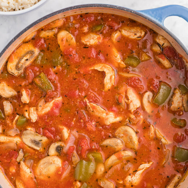 One-Pot Chicken Cacciatore - This is a delicious pantry staple casserole. Made with common ingredients like chicken, green peppers, mushrooms, onions and canned tomatoes, you can throw the ingredients in just one pot - quick to make and quick to clean up!