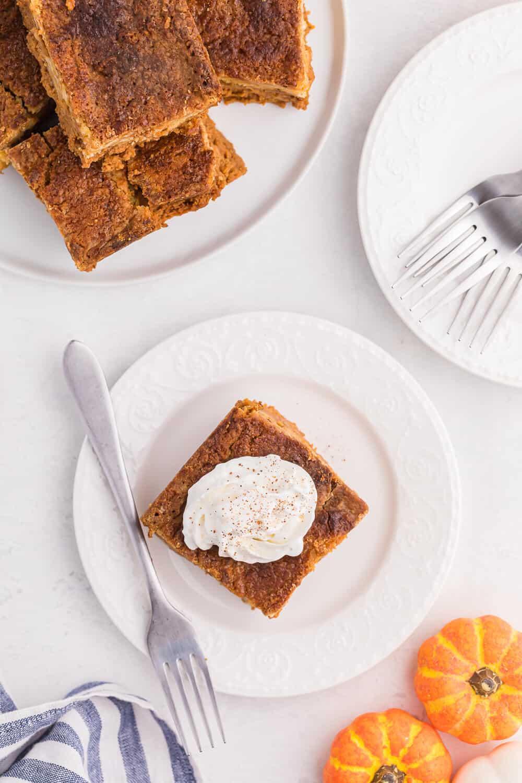 pumpkin dump cake slice on a plate with a fork
