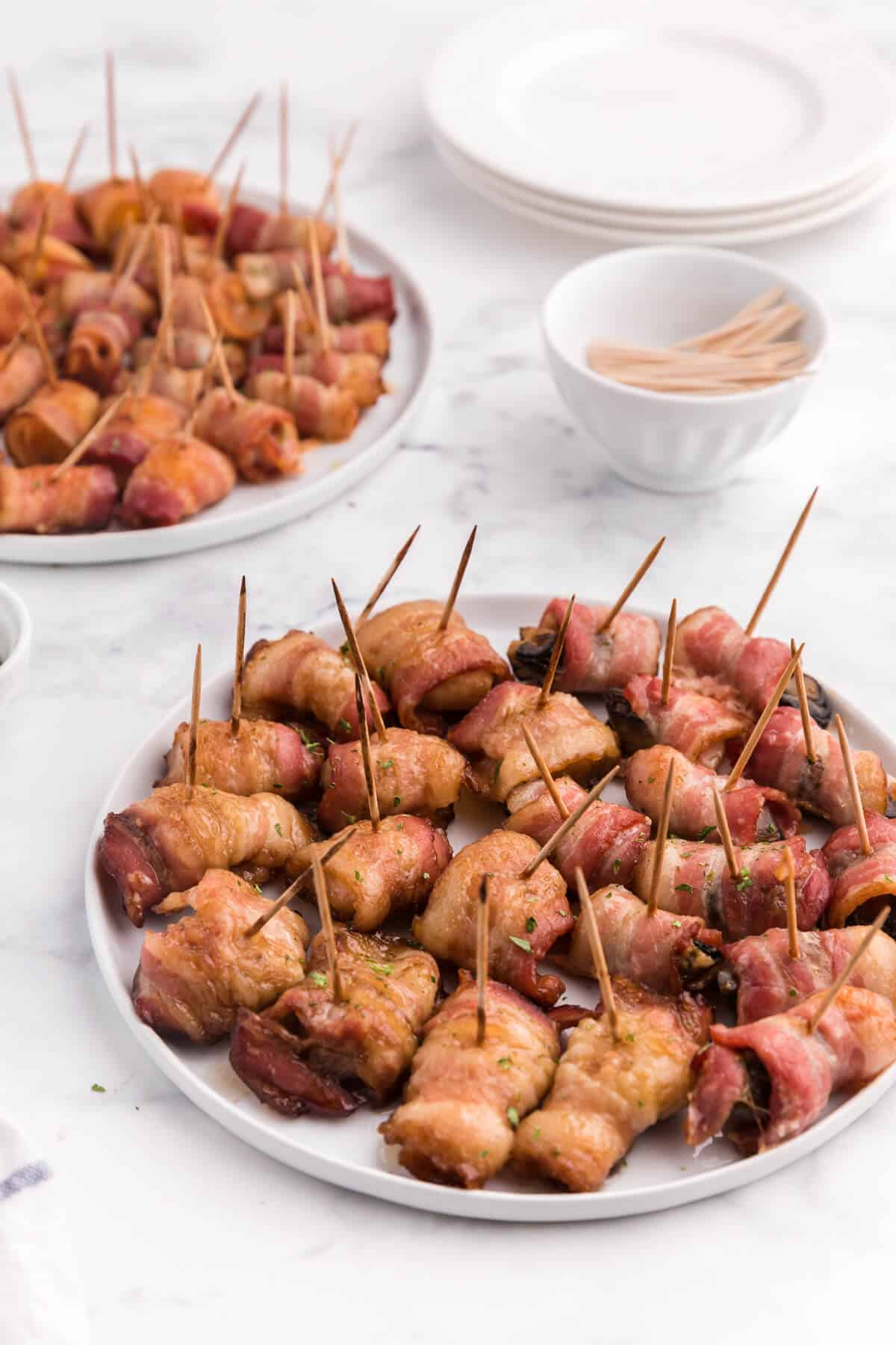 Bacon Wrapped Appetizers - Bite sized and addicting! Try four varieties - bacon wrapped water chestnuts, bacon wrapped smoked oysters, bacon wrapped pineapple and bacon wrapped olives.