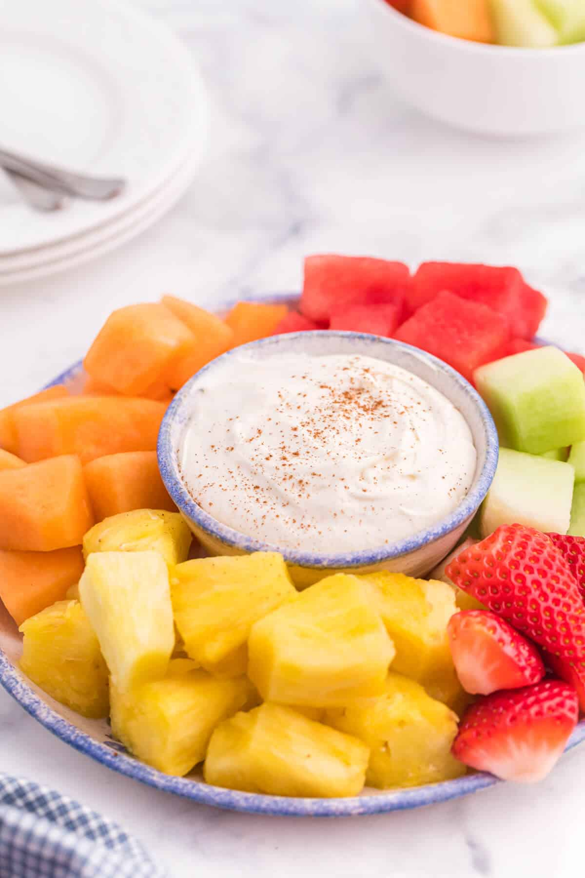 Cinnamon Cream Cheese Dip - Only four ingredients in this simple fruit dip. It's super easy to whip up and can be made the night before and kept in the fridge. Try with fruit, cookies or sweet crackers.