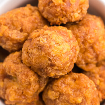 Olive Cheese Balls - A holiday favorite with a vegetarian twist! These perfect hors d'oeuvres are packed with olives, cheese, paprika, Worcestershire sauce, and a pinch of cayenne pepper.