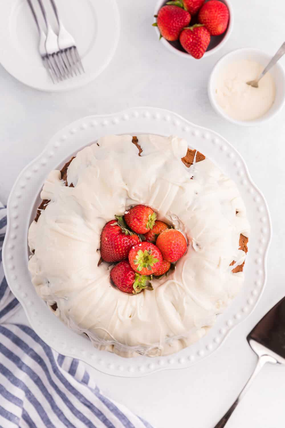 Vanilla Cream Cheese Cake on a a white background with strawberries
