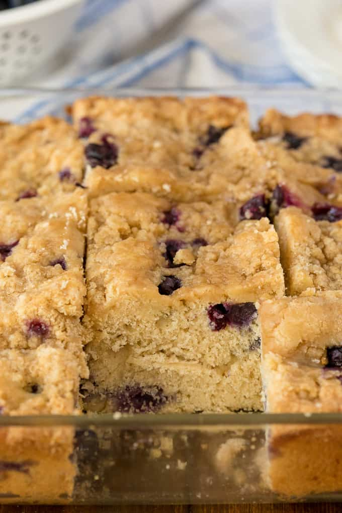 Blueberry Buckle - A single layer of blueberry cake with a sweet streusel topping. Serve with a scoop of vanilla ice cream!