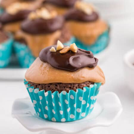 peanut butter brownie cupcake on a cupcake stand