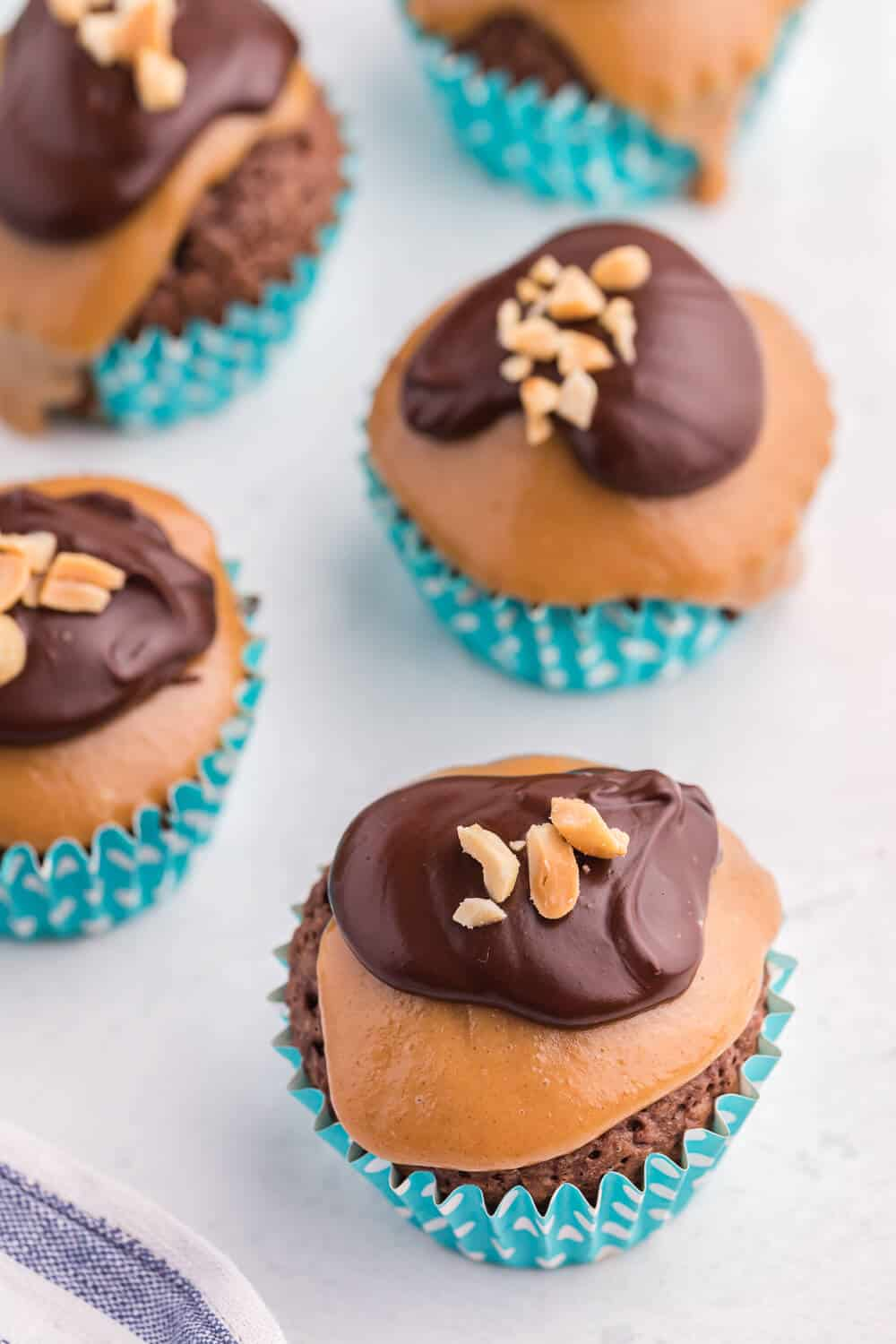 peanut butter brownie cupcakes on a white board