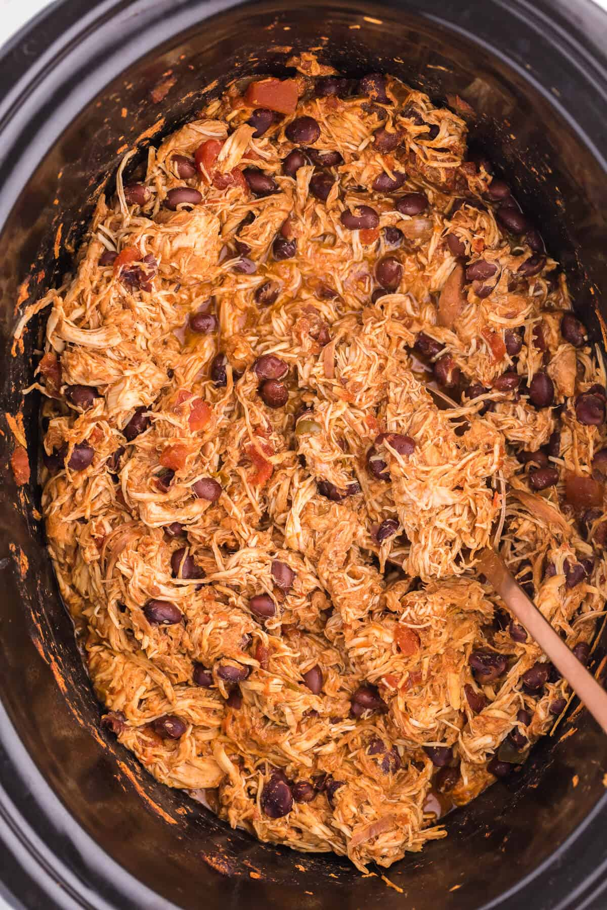 Slow Cooker Salsa Chicken - The EASIEST Crockpot recipe ever! Tender chicken breasts stew all day in a chunky salsa for an amazing busy day dinner.