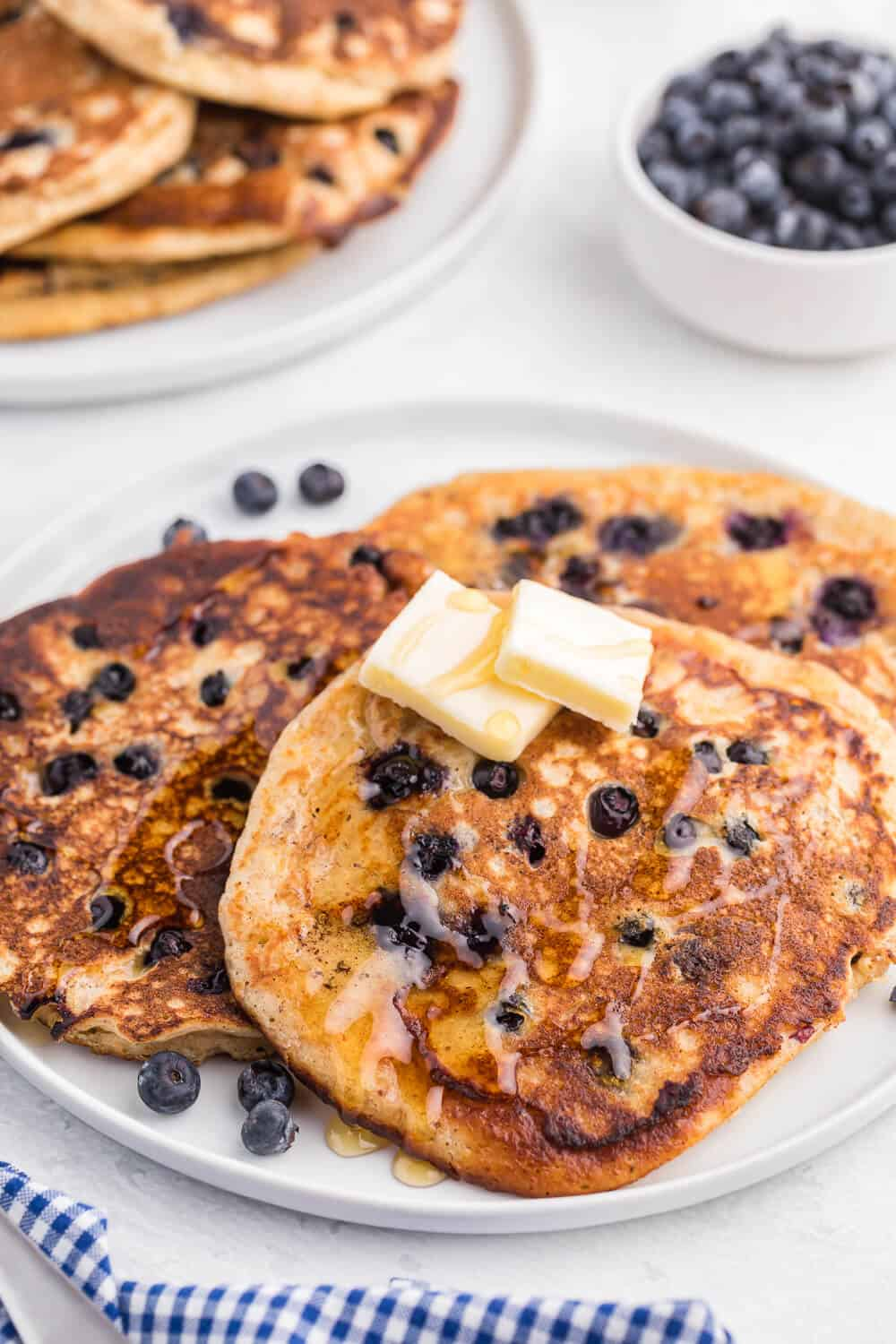 Whole Wheat Blueberry Pancakes - Blueberries are a wonder food, packed with fibre and antioxidants. Mixed into a light and fluffy whole wheat batter, these are a great way to add some extra nutrition without sacrificing delicious flavour.