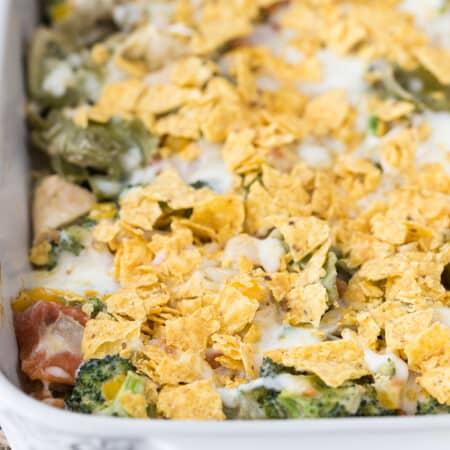 Santa Fe Chicken Tortellini Casserole - Creamy tortellini pasta with veggies topped with crunchy tortilla chips.