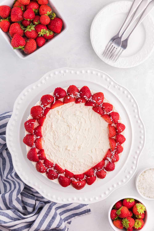 A whole no-bake strawberry cheesecake