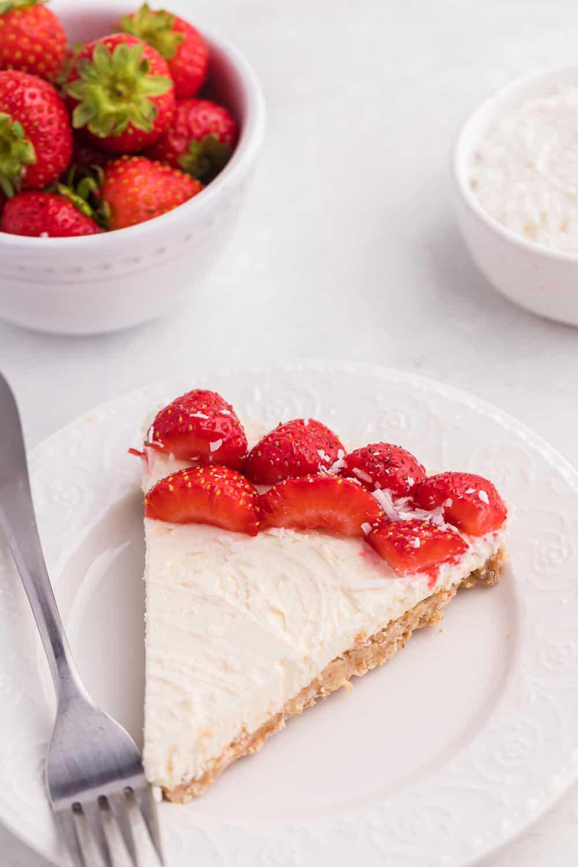 A slice of no-bake strawberry cheesecake