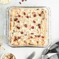 White Chocolate Cranberry Cheesecake Bars - Cheesecake + shortbread cookie = WOW! These cheesecake bars combine crunchy shortbread with the decadence of cheesecake and the tang of cranberries. It's a fantastic combination!