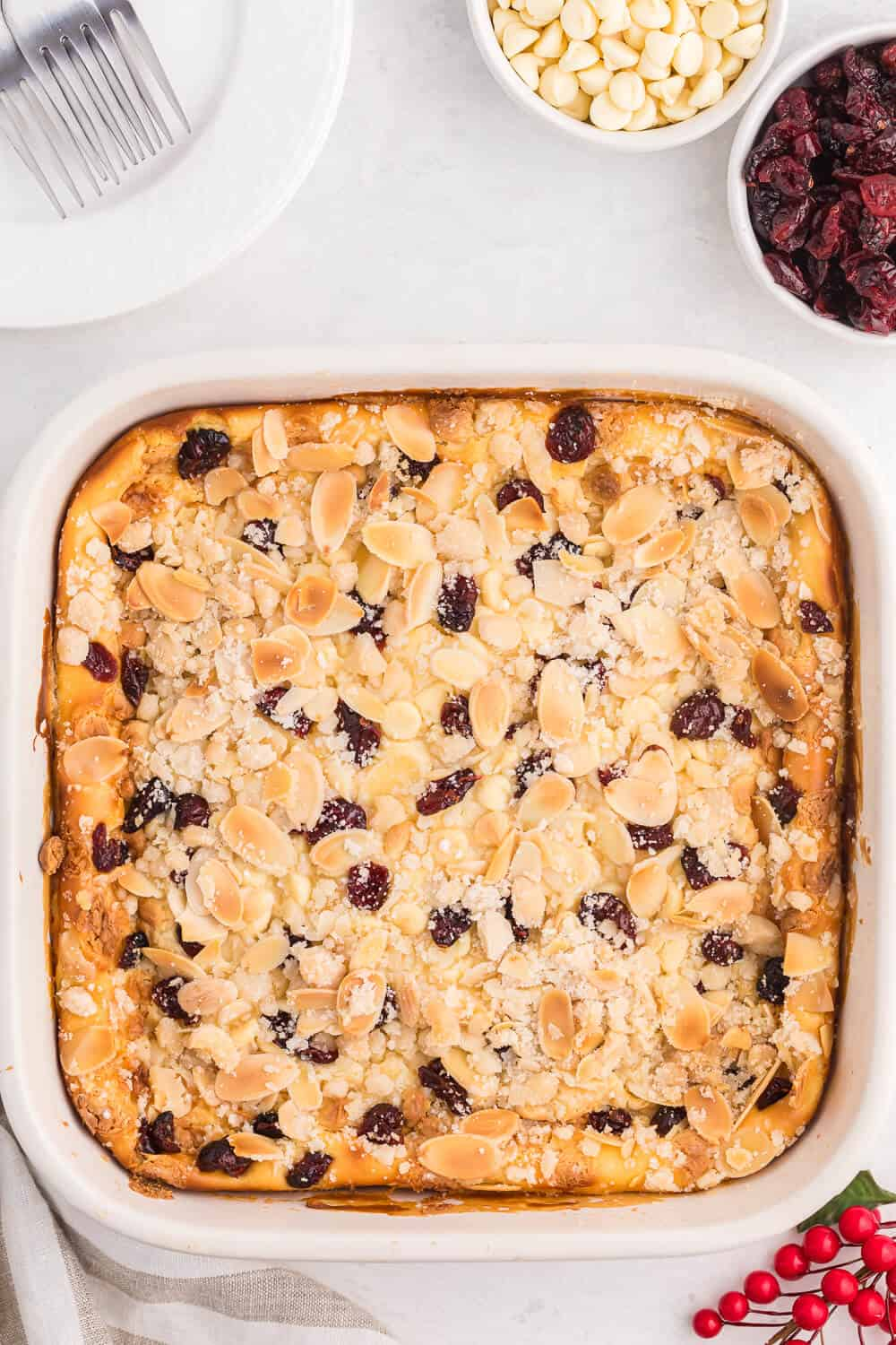 A pan of white chocolate cranberry cheesecake bars