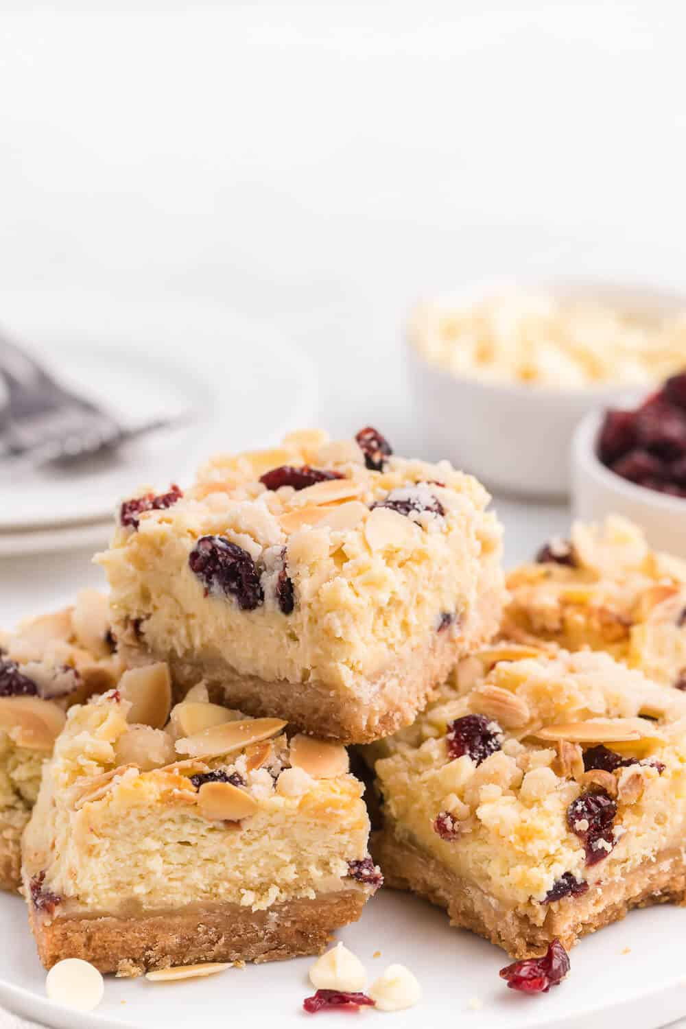 A plate of white chocolate cranberry cheesecake bars