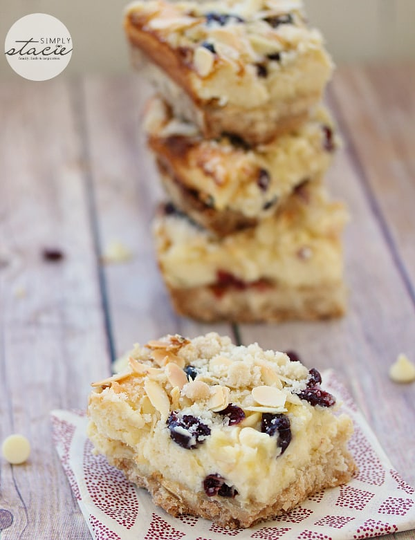 White Chocolate Cranberry Cheesecake Bars - A smooth, creamy, rich cheesecake filling and a crunchy shortbread cookie crust base makes for a divine dessert!