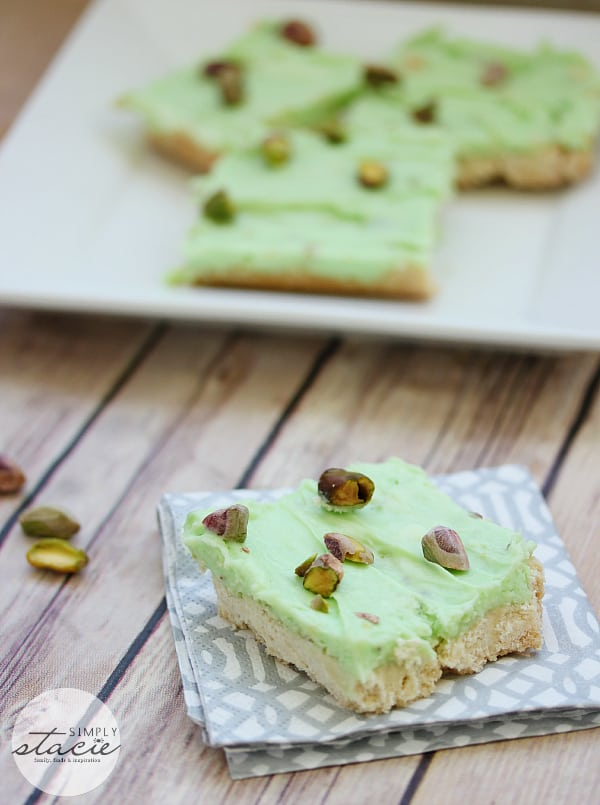 Pistachio Cream Bars - Made with a shortbread cookie base and filling that is a cross between a pudding and cheesecake. This vibrantly coloured dessert is a great make-ahead dish for entertaining. The crowd pleasing flavour of pistachio will be a winner!