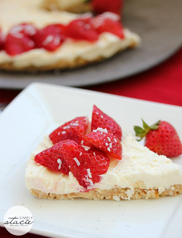 Strawberry No-Bake Cheesecake - This is the perfect way to showcase delicious, fresh strawberries! A sweet and crunchy coconut crust is paired with a smooth, creamy no-bake cheesecake and gorgeous red strawberries - the perfect early summer dessert.