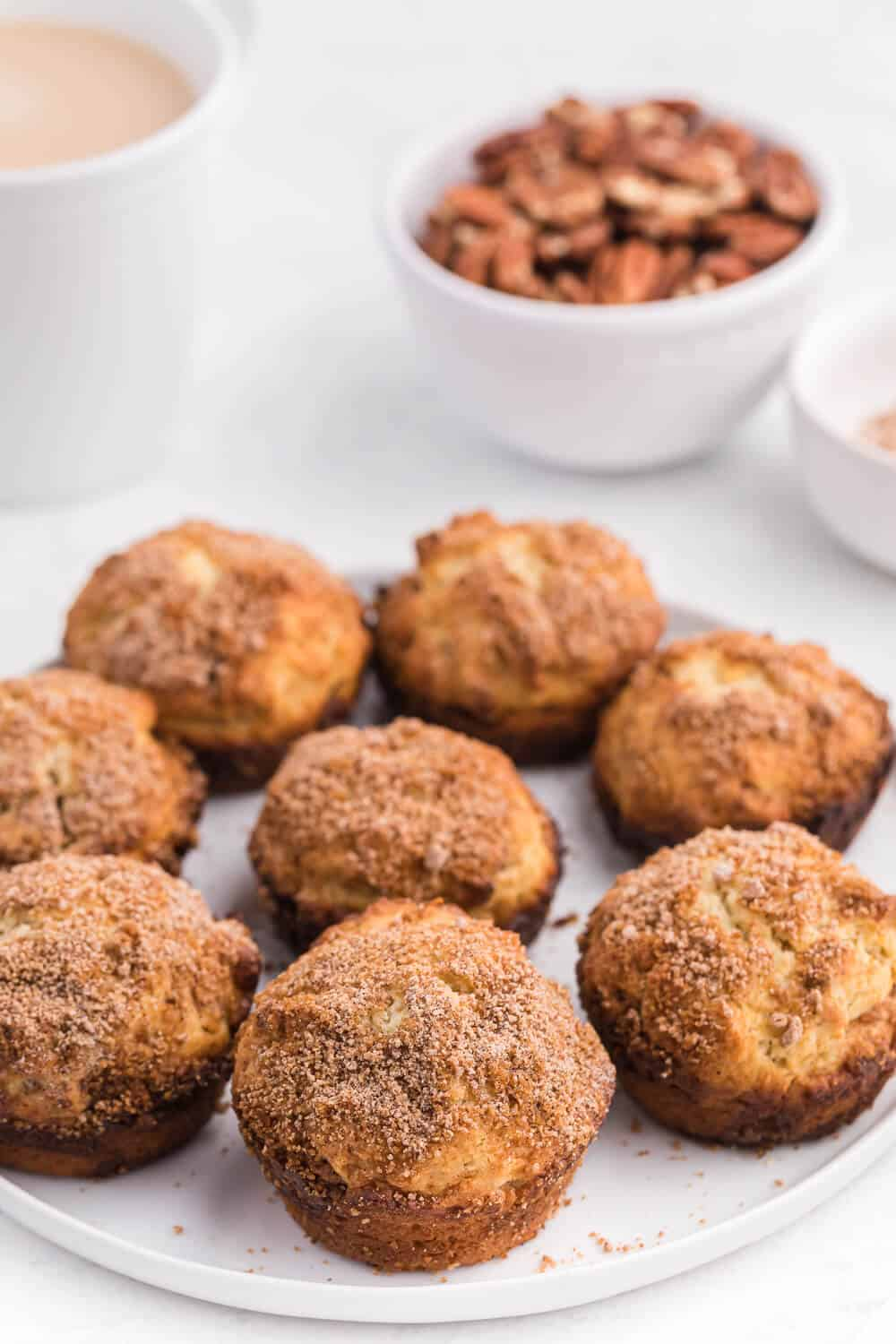 pecan coffee cake muffins on a white plate