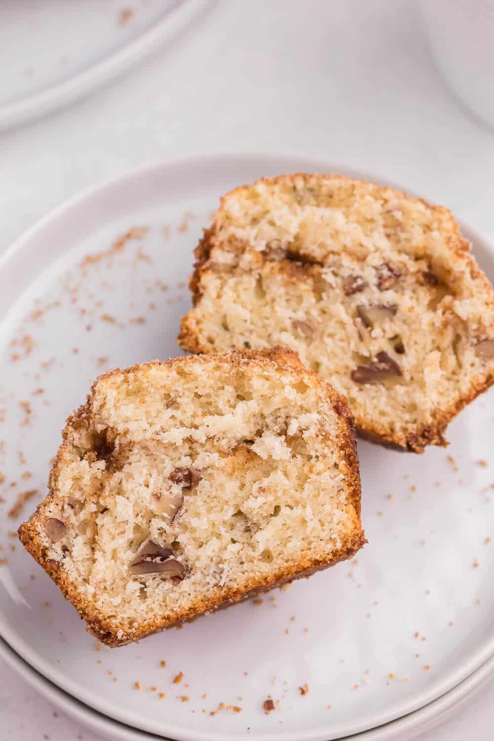 Sliced pecan coffee cake muffins a plate