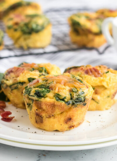 Spinach & Cheese Egg Muffins - a mini frittata made with bacon, onions, cheese and spinach. Always a breakfast fave!