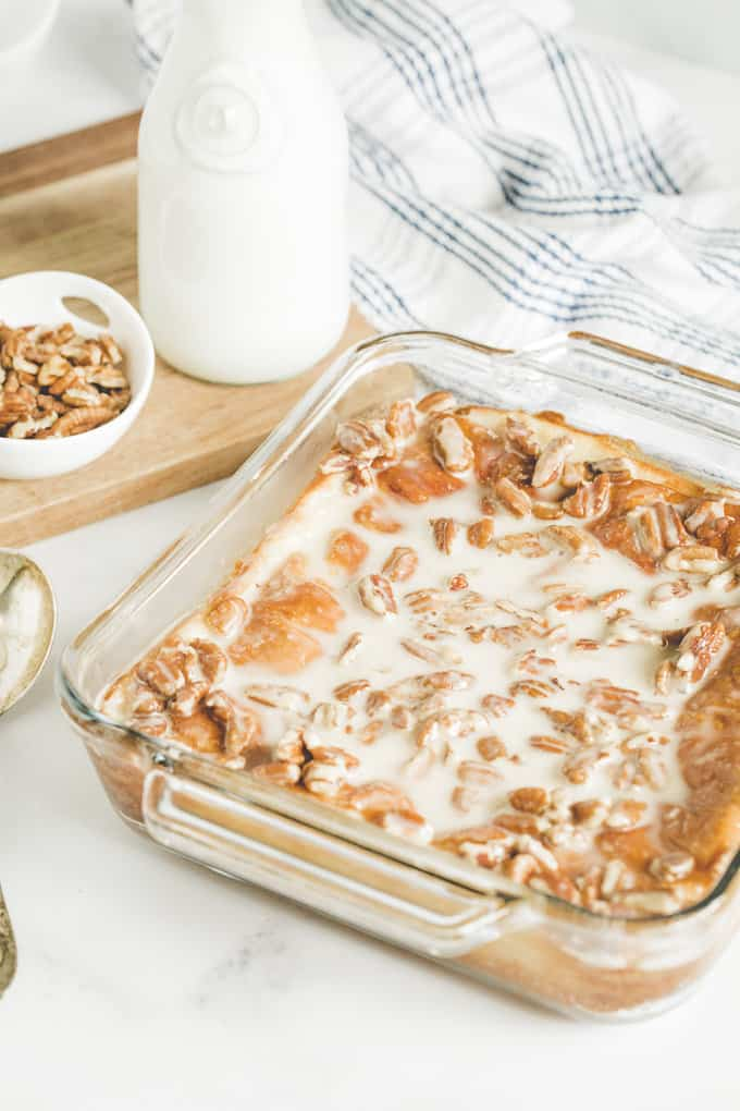 Maple Pecan Danish Bake - Danishes are a delicious treat and this easy dessert has all of the flavours we love. Using convenient refrigerated crescent rolls, this is a simple dish make. It's sweet and decadent!