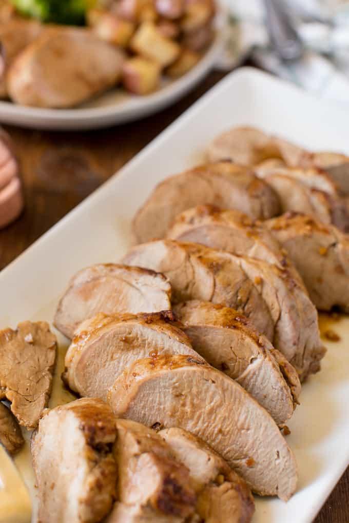 Honey Glazed Pork Tenderloin - Juicy & tender with a sweet honey garlic glaze with a hint of heat!