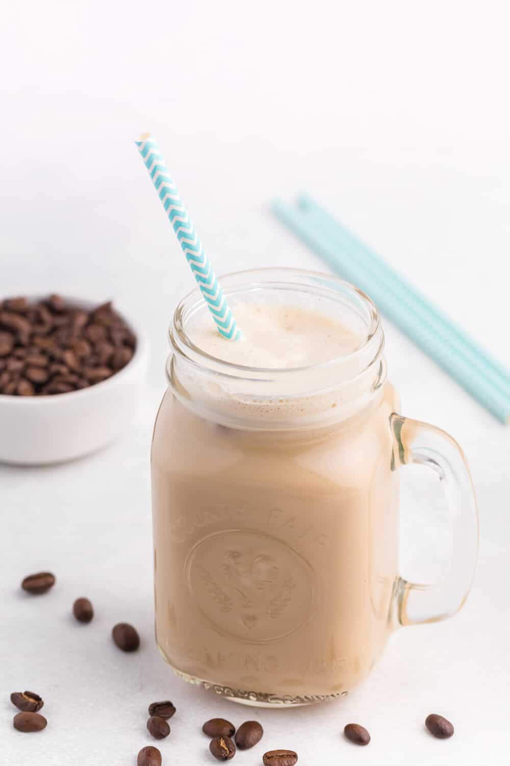 The Best Iced Coffee Ever - Cold, creamy sweet perfection! This easy summer drink can be whipped up in a minute. Made with a secret ingredient that brings it to the next level.