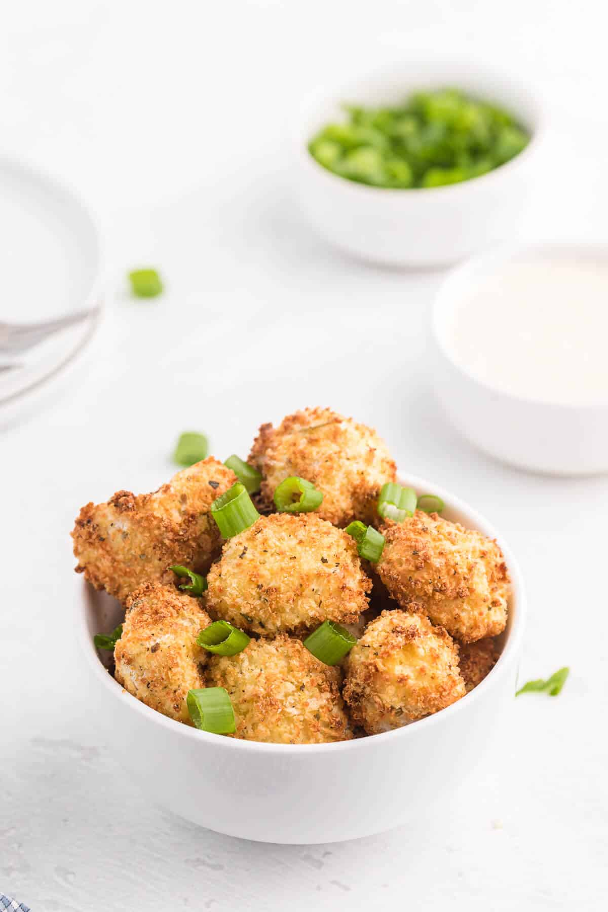 Air Fryer Cauliflower Bites - Get your kids to eat their veggies! Air fried cauliflower that's the perfect side dish or appetizer for dipping.