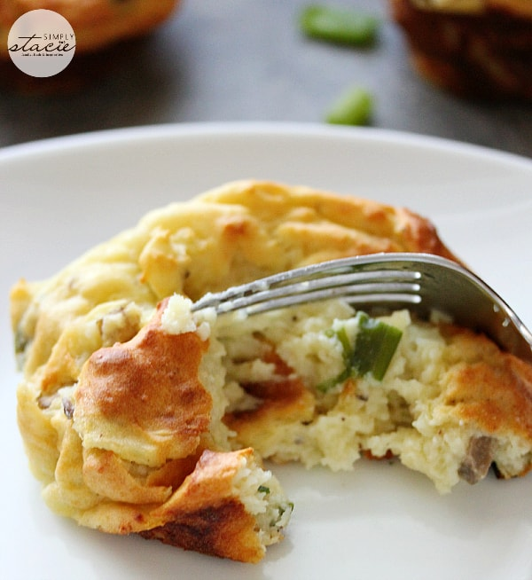 Muffin Tin Mashed Potatoes - Perfect for dinner parties! These loaded mashed potatoes are baked like savory cupcakes with mushrooms and green onions. The best way to use up leftover mashed potatoes!